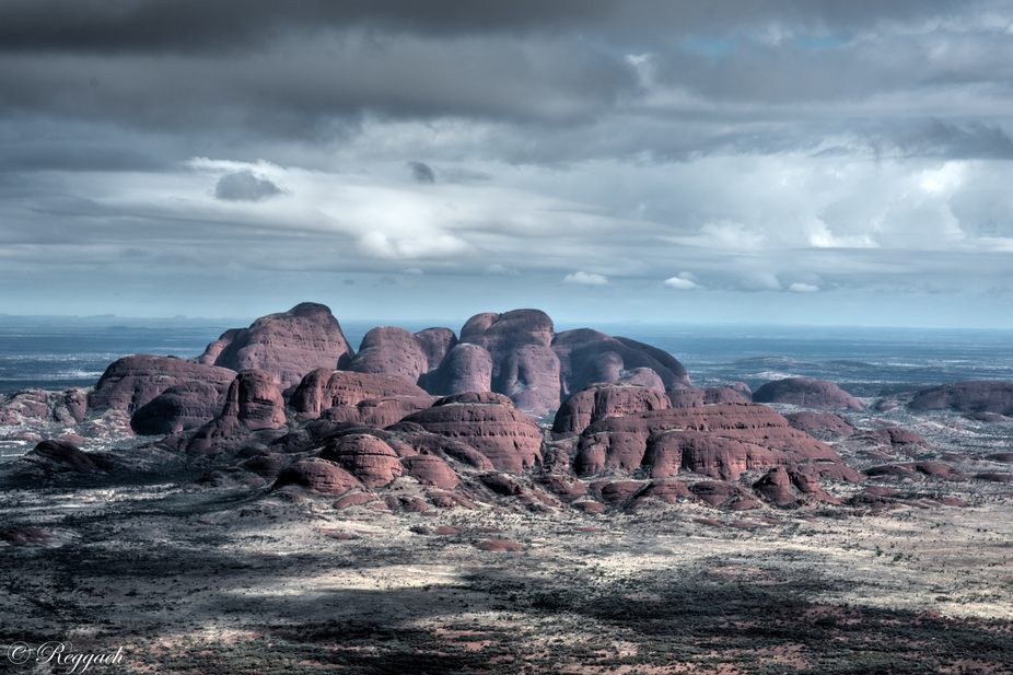 Taken on the approach to Kata Tjuta. It was a beautiful day with clouds on the horizon. The aura ...